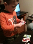 Sweet Boy playing his first hand of UNO